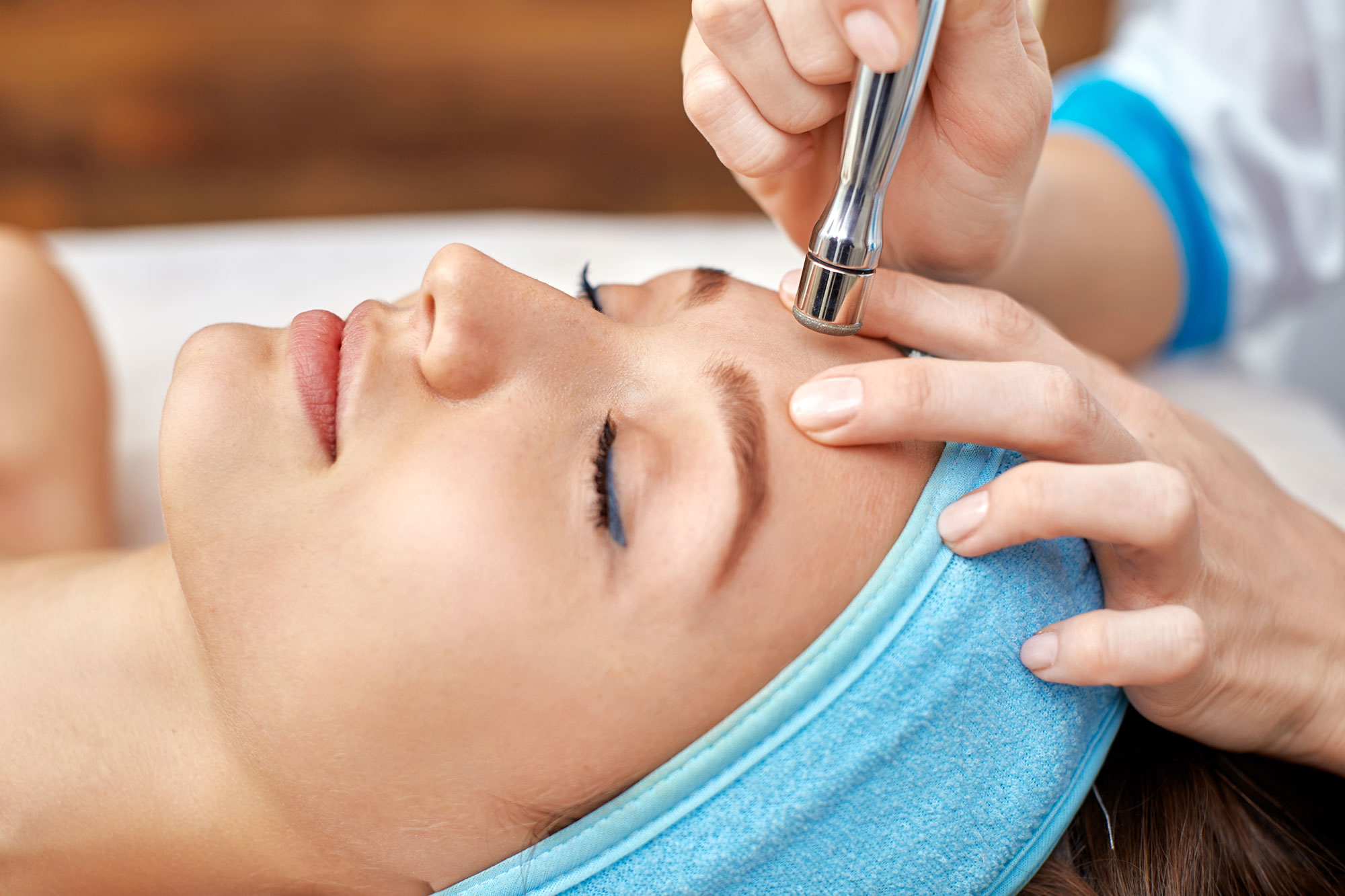 Woman getting microdermabrasion